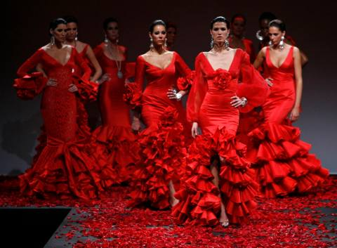Models present creations from Vicky Martin Berrocal during the International Flamenco Fashion Show in Seville